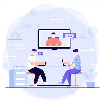 Büroangestellte, die am arbeitsplatz mit einer videokonferenz zusammenarbeiten, um soziale distanz zu bewahren.