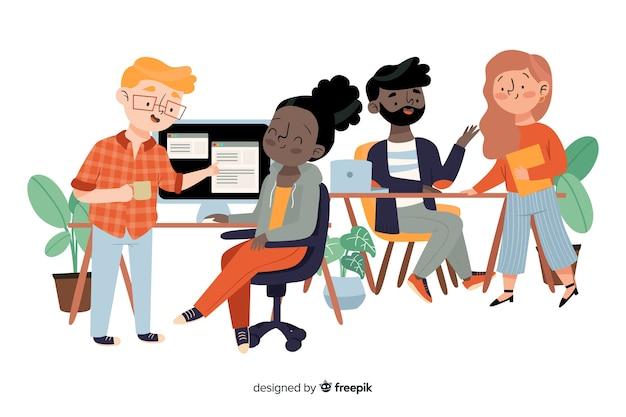 Büroangestellte sitzen an schreibtischen