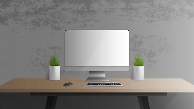Büroarbeitsplatz. monitor, tastatur, computermaus, tischlampe, zimmerpflanze.