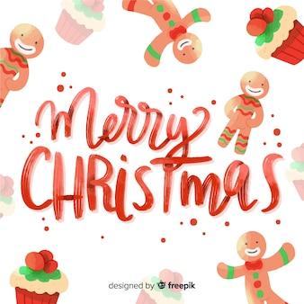 Bunte beschriftung der frohen weihnachten mit lebkuchen