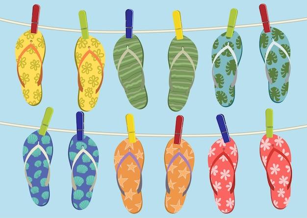 Bunte flip flops hängen am seil. sommerillustration.