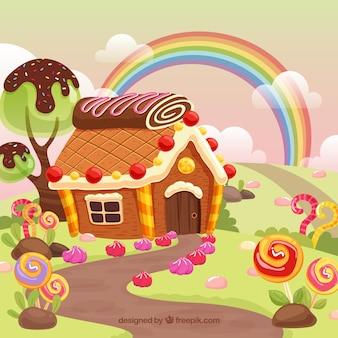 Bunte gezeichnete art des süßigkeitslandhintergrundes in der hand