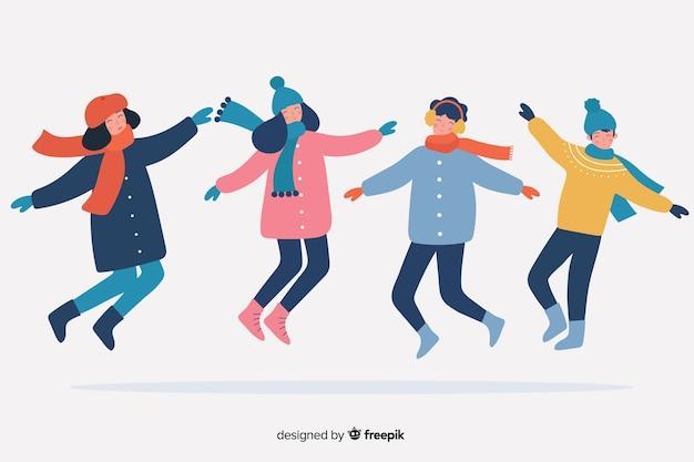 Bunte glückliche gruppenleute, die winterkleidung springen und tragen