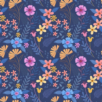 Bunte hand zeichnen blumen auf blaues nahtloses muster der farbe für textil-tapeten des stoffes.