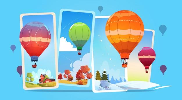 Bunte luftballone, die in himmel über sommer- und winter-schnee-landschaft fliegen