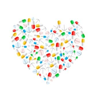 Bunte pillen in der herzform lokalisiert auf weiß