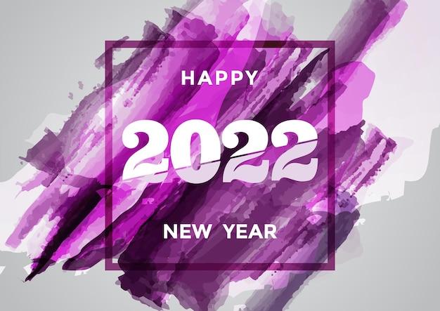 Bunte pinselstrichfarbe, die kalligraphie des hintergrundes des guten rutsch ins neue jahr 2022 beschriftet