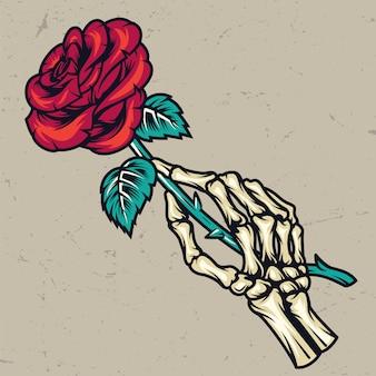 Bunte skeletthand, die schöne rose hält