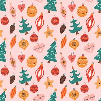 Bunte weihnachtsbaumspielzeug auf rosa hintergrund, vektor nahtlose muster im flachen stil.