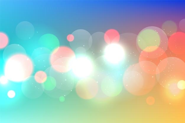Bunter bokeh-hintergrund mit funkelnden partikeln