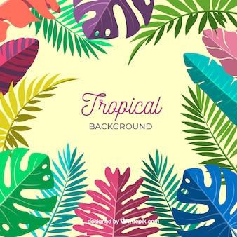 Bunter tropischer hintergrund mit blättern und blumen