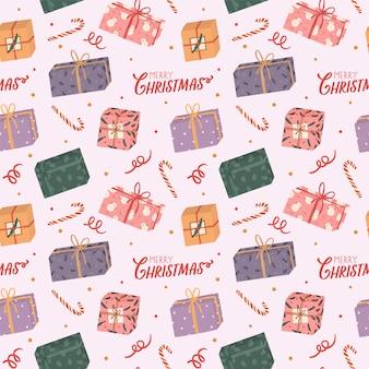 Buntes nahtloses muster für weihnachten und neues jahr mit feiertagsbeschriftung und traditionellen weihnachtselementen.