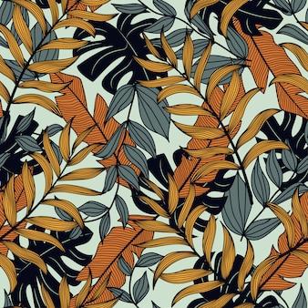 Buntes nahtloses muster mit den dunklen und gelben tropischen anlagen und den blättern