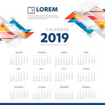 Buntes schablonenschreibtischbüro des kalenders 2019 neues jahr