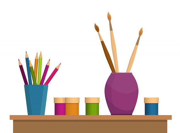Buntstifte, pinsel und farben auf dem tisch