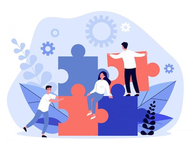 Business-team beim aufbau einer puzzle-lösung