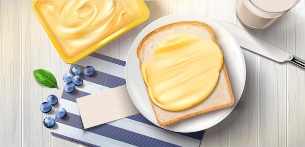 Butteraufstrich auf brot, leckeres frühstück mit buttertoast und milch, draufsicht top