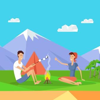 Camping zelt in der nähe von feuer und bergen. glückliches paar