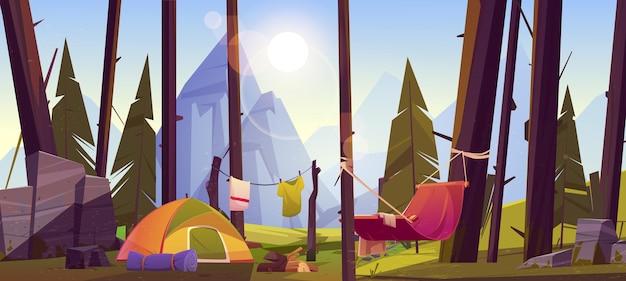 Campingzelt mit touristenmaterial und hängematte