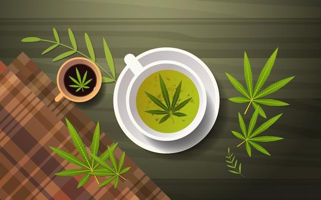 Cannabis-kräutertee-marihuana-blätter auf der horizontalen ebene des oberen hintergrundwinkels des hölzernen hintergrunds