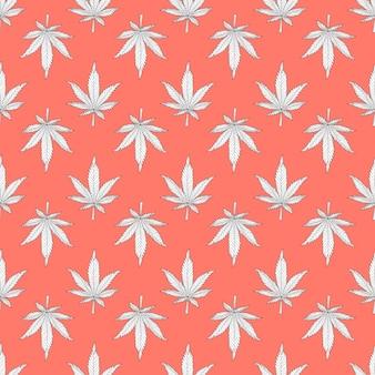 Cannabis nahtloses muster weiße hanfblätter auf einem orangefarbenen hintergrund