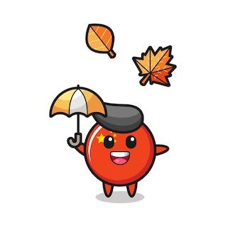 Cartoon des niedlichen china-flaggenabzeichens, das im herbst einen regenschirm hält, niedliches design für t-shirt, aufkleber, logo-element