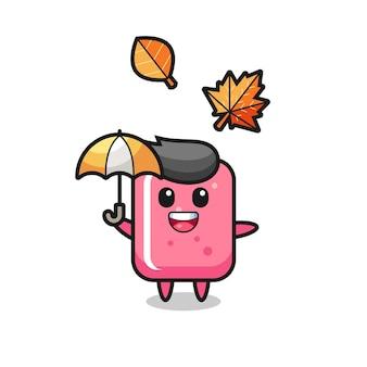 Cartoon des niedlichen kaugummis, der im herbst einen regenschirm hält, niedliches design für t-shirt, aufkleber, logo-element
