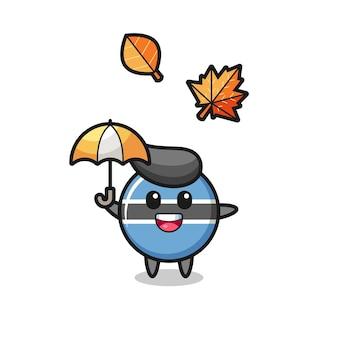 Cartoon des süßen botswana-flaggenabzeichens, das im herbst einen regenschirm hält, niedliches design für t-shirt, aufkleber, logo-element