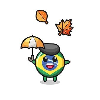 Cartoon des süßen brasilianischen flaggenabzeichens, das im herbst einen regenschirm hält, niedliches design für t-shirt, aufkleber, logo-element