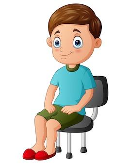 Cartoon ein junge, der auf dem stuhl sitzt