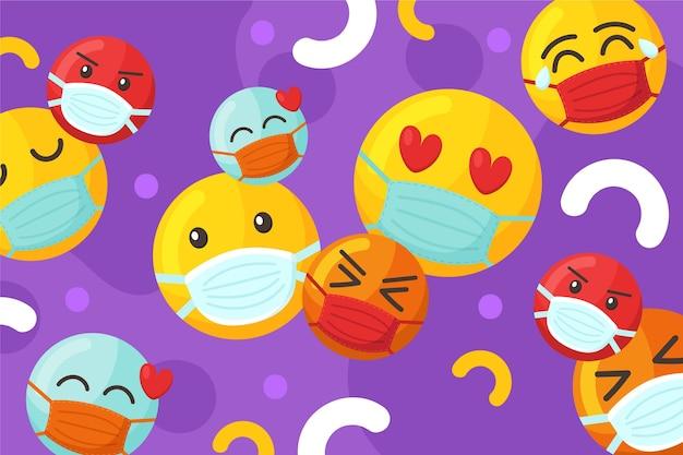 Cartoon-emoji mit gesichtsmaskenhintergrund