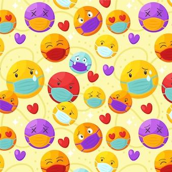 Cartoon-emoji mit gesichtsmaskenmuster
