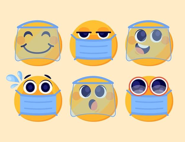 Cartoon-emoji mit gesichtsmaskenpaket