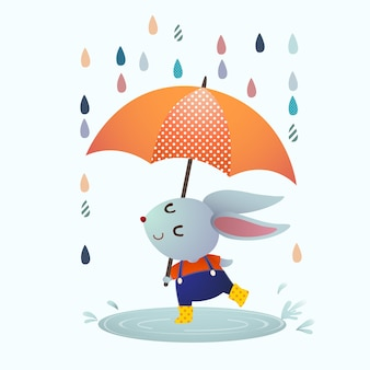 Cartoon graues kaninchen, das in einer pfütze an regnerischem tag spritzt.