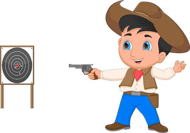 Cartoon-junge verkleidet als cowboy und schießt mit einer waffe