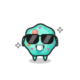 Cartoon-maskottchen der amöbe mit cooler geste, süßem stildesign für t-shirt, aufkleber, logo-element