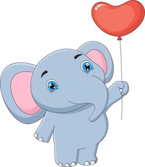 Cartoon niedlicher elefantenbaby mit ballon