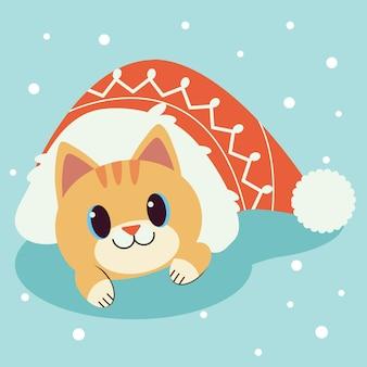 Charakter der süßen katze in großen roten hut auf dem blauen grund und weißen schnee.