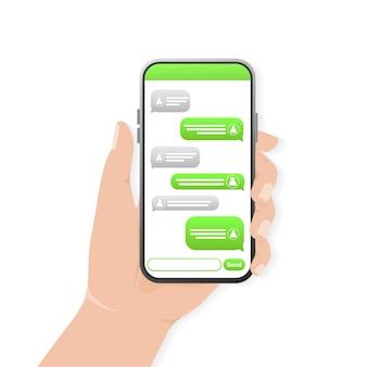 Chat-bildschirm mit der hand. textnachricht. grüne chatblase. smartphone-bildschirm.