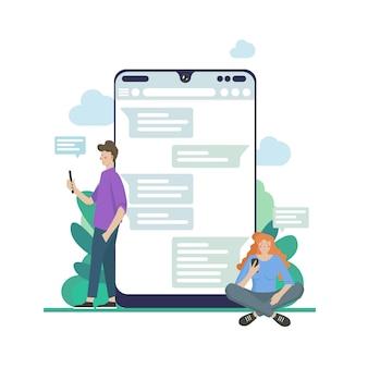 Chat-talk-konzept-illustration von jungen menschen, die laptops verwenden, um sich gegenseitig nachrichten über den internet-messenger zu senden. flacher mann und frau sitzen auf den großen sprechblasen und tippen nachrichten