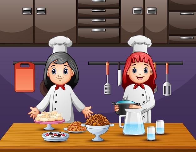 Chef mit zwei frauen, der lebensmittel in der küche zubereitet