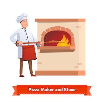 Chefkoch putting pizza zu einem backstein stein ofen