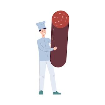 Chefkochmanncharakter mit der riesigen wurst in den händen, flach isoliert. professionelle kochpersönlichkeit für kulinarische und kulinarische themen.