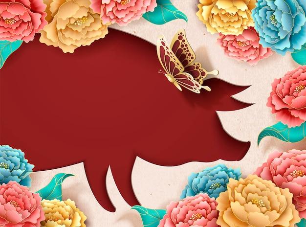 Chinesische neujahrsplakatschablone mit pfingstrosenblüten und schweinchenform hohl