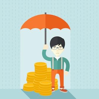 Chinesischer geschäftsmann mit regenschirm als schutz für seine investition.