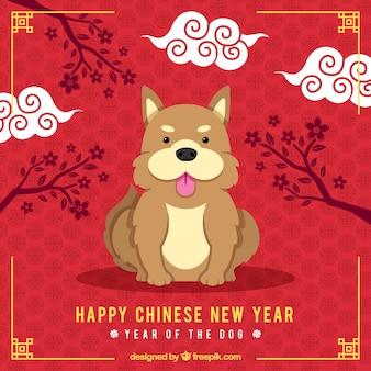 Chinesischer hintergrund des neuen jahres mit nettem hund