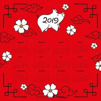 Chinesischer kalender des neuen jahres des schweins und der blumen