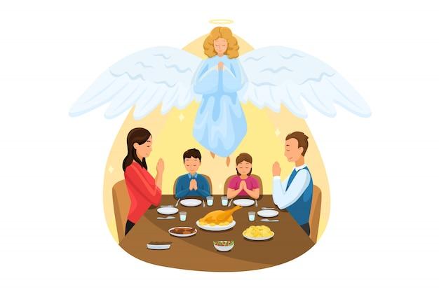 Christentum, religion, essen, schutz, gebet, anbetungskonzept. engel biblischer religiöser charakter, der junge familie vater sohn tochter mutter beim abendessen oder frühstück beim beten beobachtet. göttliche unterstützung