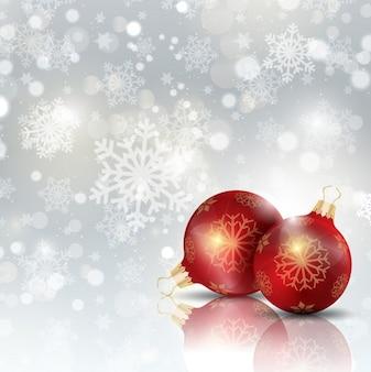 Christmas ball auf einem hintergrund mit schneeflocken