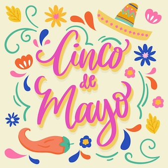 Cinco de mayo schriftzug mit mexikanischen elementen